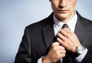 Man getting dressed for work. Businessman in suit and tie.